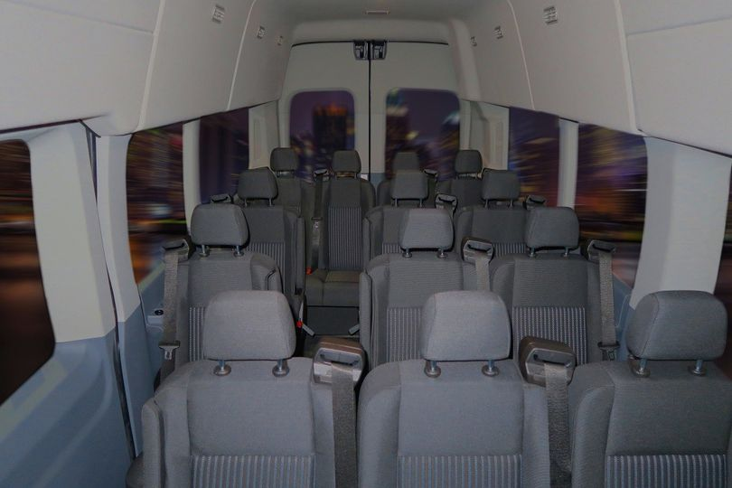 Our 14 passenger gray transit van is roomy with comfortable seating. A perfect choice for...