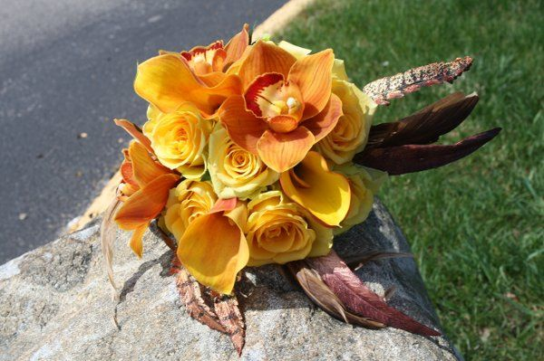 fall bridal boquet with feathers