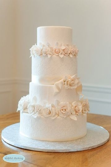 white and ivory cake with sugar paste roses