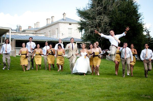 Fun bridal party shot running down the hill at Ye Kendall Inn in Boerne.