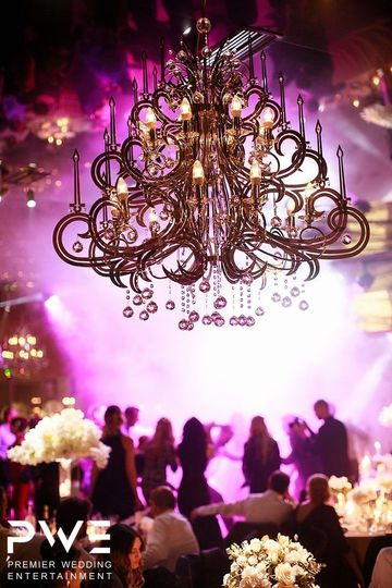 Chandelier and pink lighting at reception