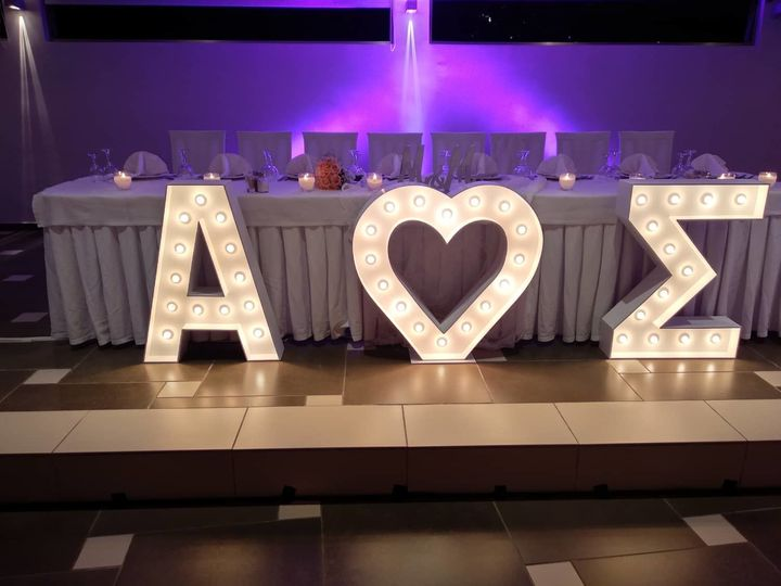 Wedding letters in front of reception table