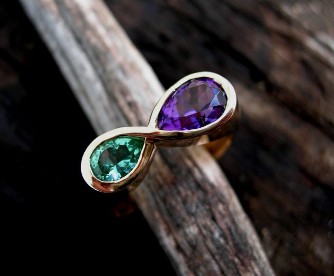Maine Tourmaline-Amethyst infinity ring. For more jewelry go to www.creaserjewelers.com. Find us and...