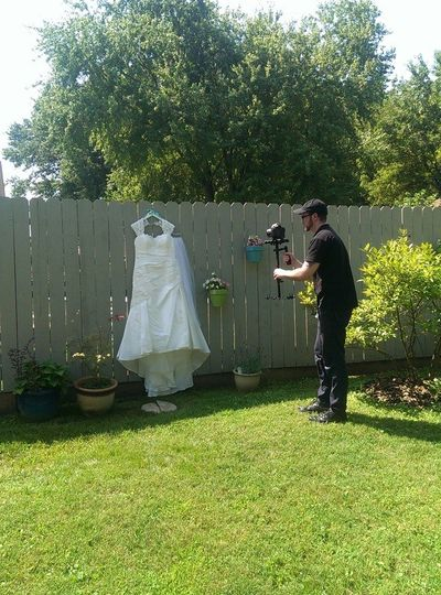 Me (Ethan) filming a dress during bride prep.