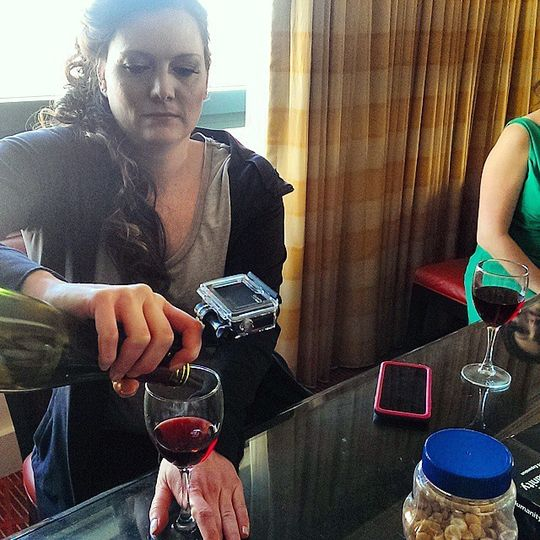 Getting a GoPro shot of a bride pouring wine.