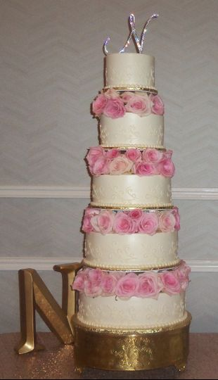 Tall wedding cake with flower layers