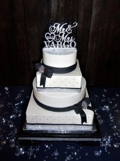 Black ribbon decorated cake