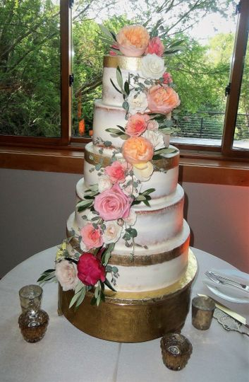 Naked wedding cake with ascending flowers