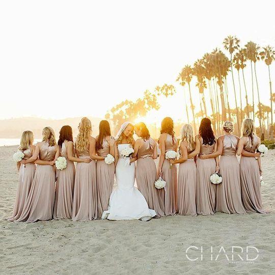 Bride and bridesmaids at the beach