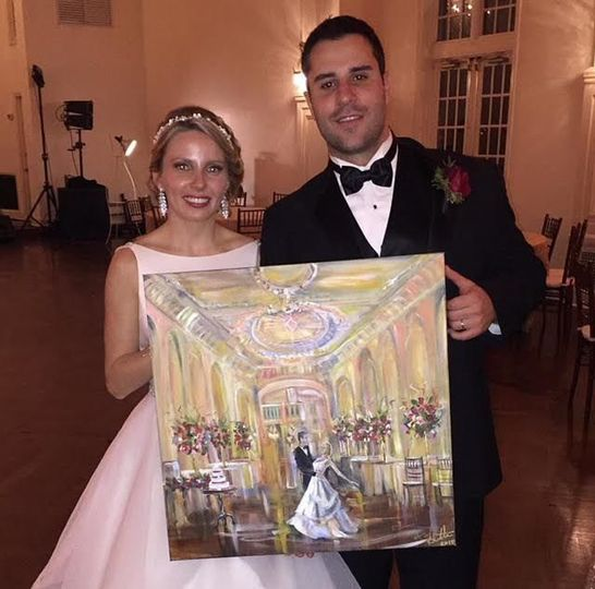 Bride and groom with their painting