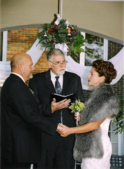 Bob Javorsky, Our Wedding Officiant presided over this wedding... and the each of the bride and...
