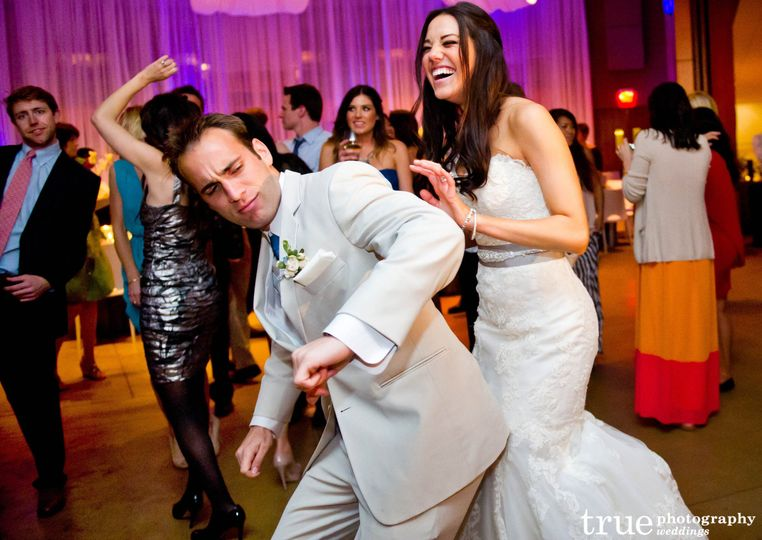 bride and groom dancing at