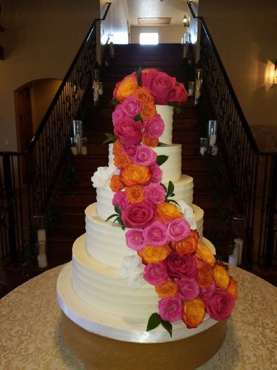 White wedding cake with vibrant flowers