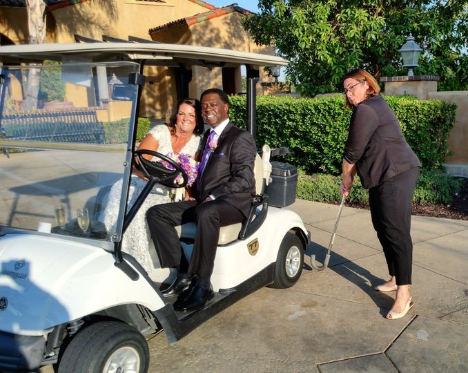Newlyweds on the golf cart