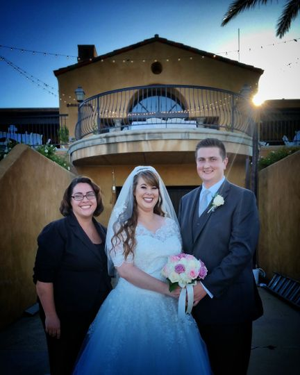 Newlywed couple with their officiant