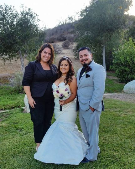 Newlywed couple and the officiant