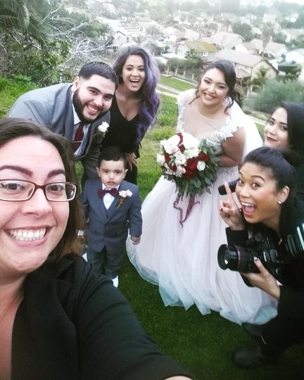 Officiant with the newlyweds and their guests