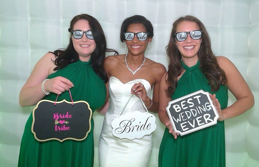 Bride and bridesmaids with props