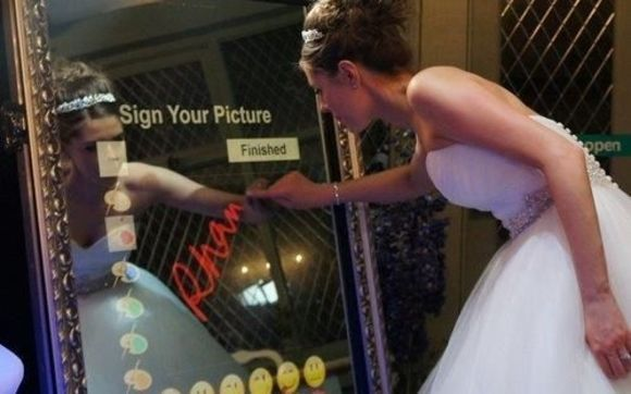 Bride signing her photo