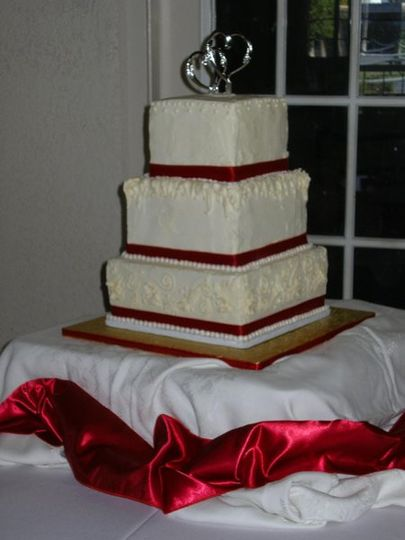 Cream cheese butter cream frosting conceals 3 tiers of decadant chocolate fudge cake.  Each tier was...