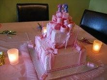 A pink ballerina cake for a 13 year old, features a strawberry flavored icing with a French vanilla...