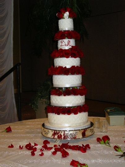 A red velvet cake covered with almond flavored fondant was made to serve 300 guests. The six tiers...