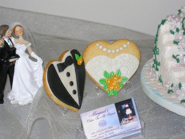 The bride and groom cookies can be made of vanilla or chocolate sugar dough with fondant tux in...