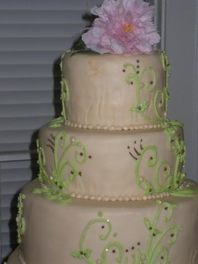 The Asian inspired piping was designed by the bride.  The grooms cake was a red frisbee.  Cake was...