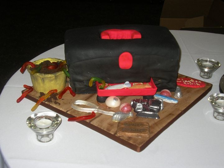 Tackle box is a fondant groom's cake with lures, worms, and bobbers.  This cake was red velvet, the...