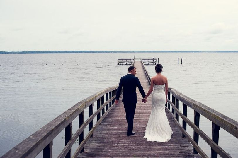 Couple photo walking down the dock