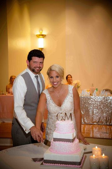 Kimball Ballroom Columbia MO wedding reception Bride and groom cake cutting