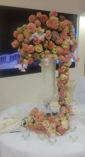 Tall centerpiece arrangement with a cascade of flowers
