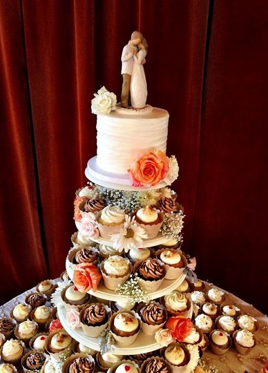 Cupcake tower with wedding cake on top