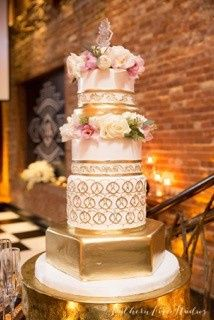 Hexagonal wedding cake with a gold layer and detailing