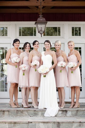 Bride and her bridesmaids by the stairs