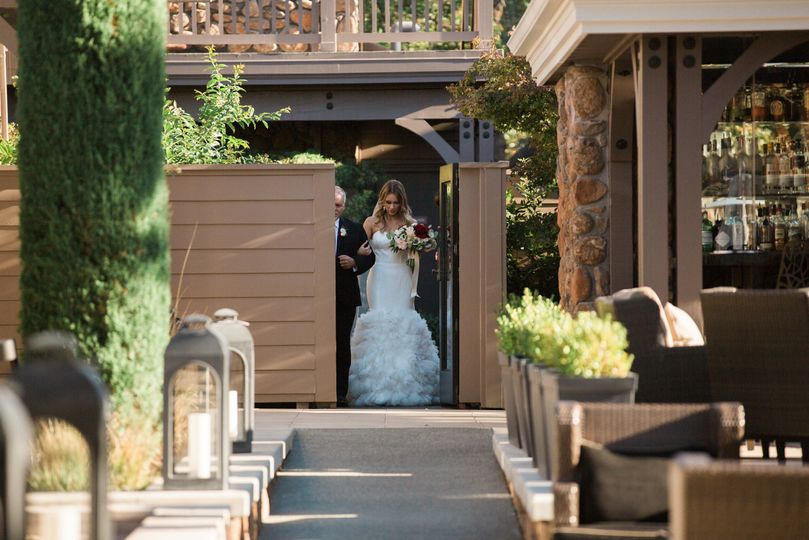 Bride being escorted  | Photo by c.m.elle studios Planning by Roque Events