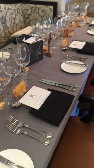Table setting   Linens: La Tavola Photographer: Michelle Walker Florals: Beau Fleurs Venue: Hotel...