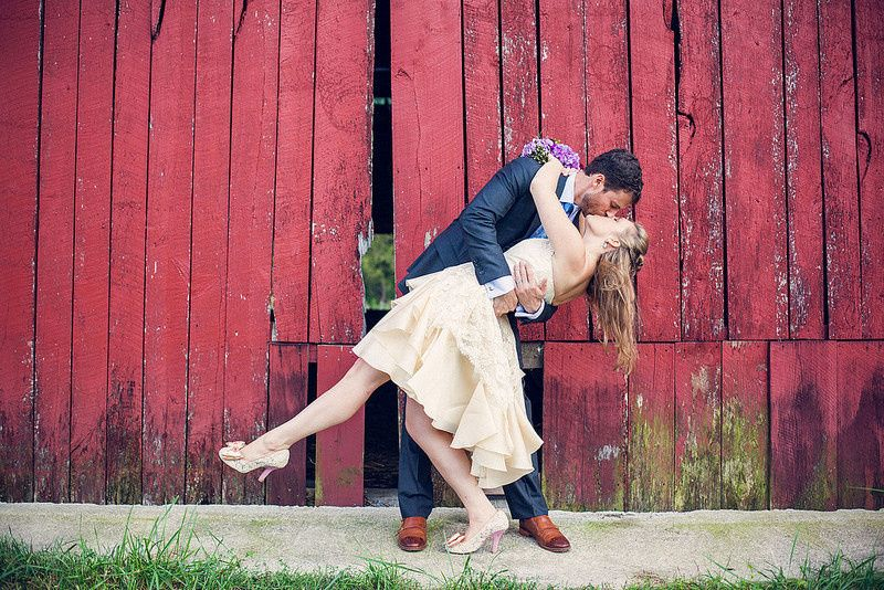 Groom dips his bride for a kiss
