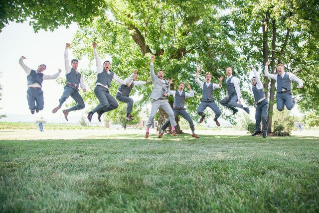 Jump shot of the groom and his groomsmen