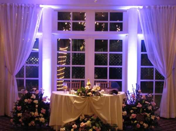 Uplighting at sweetheart table. Makes everything even more elegant and beautiful!