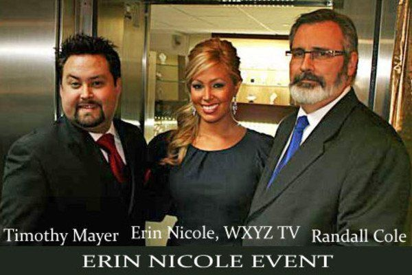 Owners Timothy Mayer and Randall Cole with celebrity Erin Nicole at the Diamond Vault of Troy