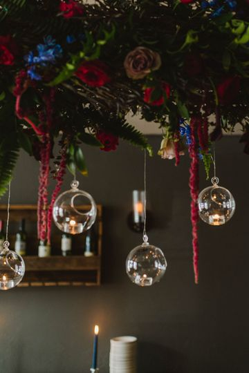 Moody jewel-toned hanging floral chandelier  | Stephanie Dee Photography