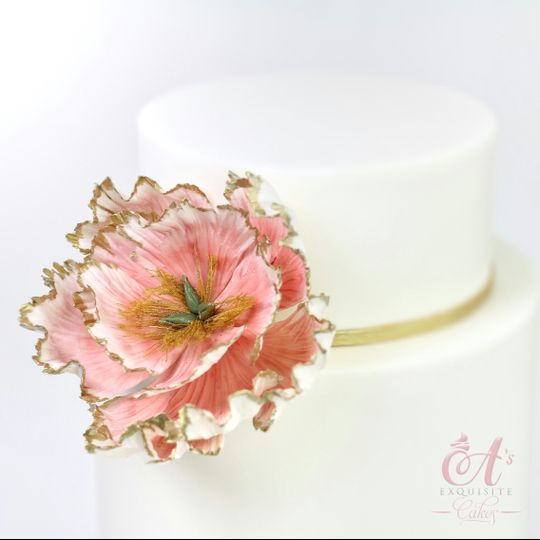 Simple wedding cake with pink flower