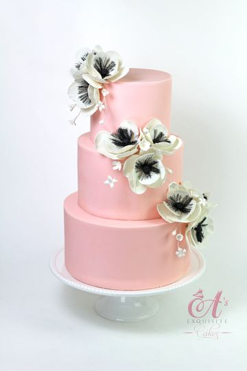 Pink wedding cake with white flowers