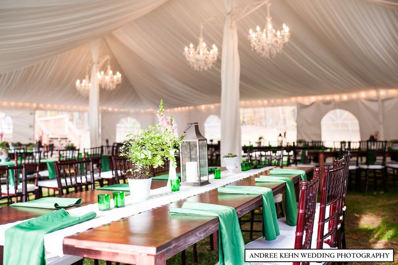 Farm tables and crystal chandeliers for a classic feel at dinner