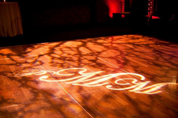 Custom monogram for dance floor with gobo patterns (photo credit: Kacie Jean photography)