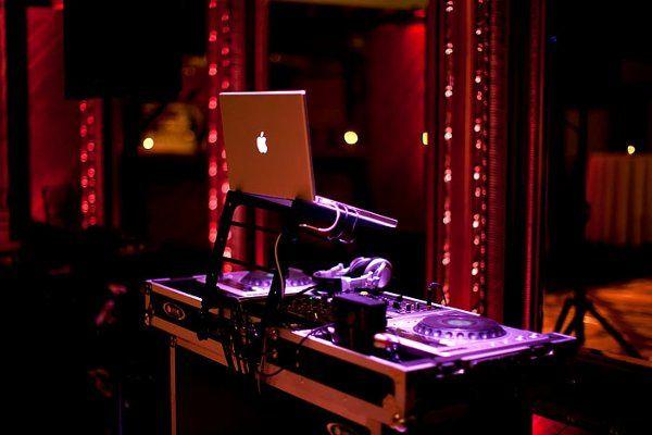 DJ setup with color wash and uplighting (photo credit: Kacie Jean photography)