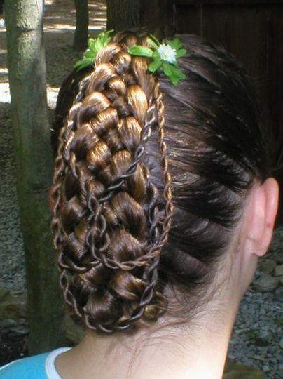 A single Five Strand braid, tucked and with three twists