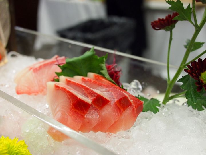 M sushi private catering yellowtail sashimi with ice clear set up for wedding events.