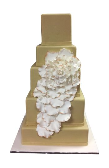 gold and white wedding cake with rustic flower ruf